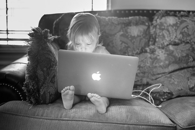 photo of toddler with laptop